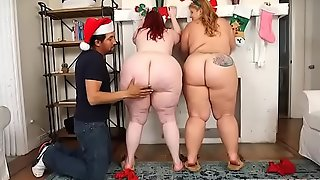 Two giant booty bbws surprise fake santa claus
